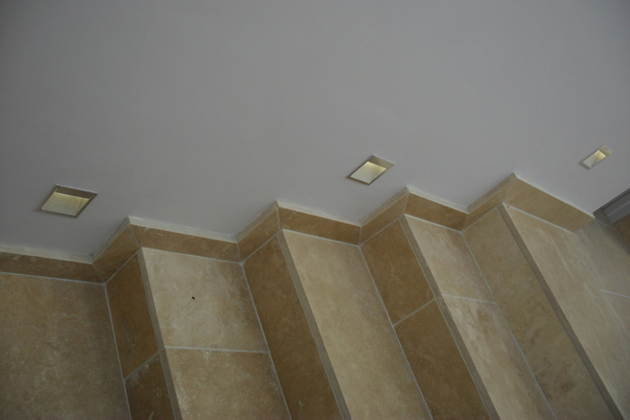 Wcec interiors slide background limestone flooring carefully detailed at steps with recessed wall lights to mark level change aloadofball Images